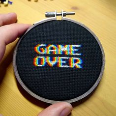 "A ""Game Over"" cross stitch piece that really does a number on your eyes! Hand Embroidery Patterns, Diy Embroidery, Cross Stitch Embroidery, Embroidery Designs, Cross Stitch Hoop, Lace Patterns, Cross Stitch Designs, Cross Stitch Patterns, Cross Stitching"