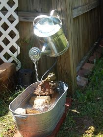 I made a watering can fountain back in September. It was a simple DIY project that added a nice, calming sound to the garden. Here's how I...