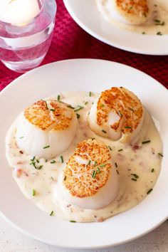Start off your date night dinner with these swoon-worthy Pan Seared Scallops with Bacon Cream Sauce.