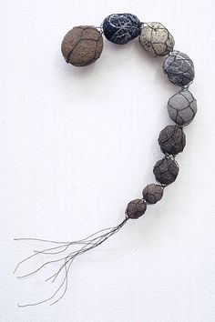 Mari Andrews:  UNTITLED #1158 , 1997  wire, stone  12 x 7 x 2 inches