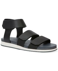 Calvin Klein ushers in warm weather fashion with these leather three-strap sandals. | Leather upper; rubber sole | Imported | Open toe | Slip-on style with strap closures | Web ID:2645843