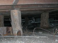 The key to maintaining a historic pier and beam house is proper drainage.   When water accumulates or flows under a pier and beam house, it may cause either heaving (uplifting) or sinking of the piers.