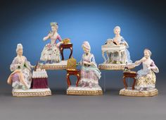 These intriguing Meissen porcelain figures embody the five senses in exquisite detail. Features blue crossed swords marks and incised model numbers. Mid-20th century.