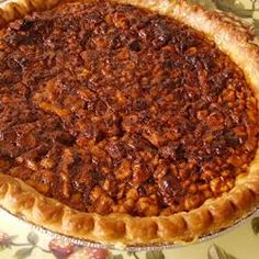 English Walnut Pie....think of a pecan pie with walnuts, a sweet and gooey pie...5 stars by Allrecipes.com-RECIPE FOLLOWS