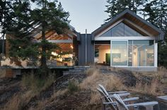 This spectacular home is located on Bowen Island, a 30 minute ferry ride from Vancouver, British Columbia. Designed by Bai Architects, the design was inspired by the old fish and boat storage struc...