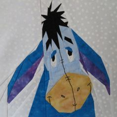 Eeyore is glad you noticed him! Free paper pieced pattern by Lynne Schwarz, only on fandominstitches.com!