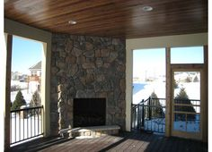 three season porch with fireplace inspiration
