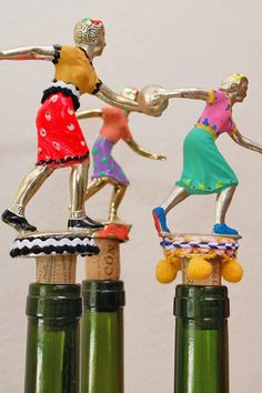 Vintage sports trophies repurposed as wine bottle stoppers