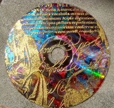 1. Color a CD with Alcohol Inks  2. Stamp on CD with Black Pigment Ink  3. Sprinkle on regular Gold embossing powder & heat emboss.