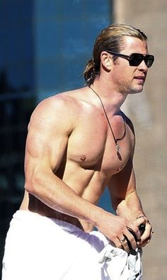 Chris Hemsworth.... Gwad he has an awesome body! I need a man with a body like this!