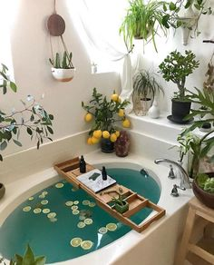 This bohemian bathroom is vivid and vibrant, the usage of the curtain set and th. This bohemian bathroom is vivid and vibrant, the usage of the curtain set and the rug as nicely as Bohemian Bathroom, Cozy Bathroom, Bohemian Decor, Bohemian Style, Bathroom Plants, Garden Bathroom, Bathroom Ideas, Bathroom Inspo, Bathrooms With Plants