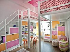 Two lofts with beds for two little girls, with fun pink and orange play area below.
