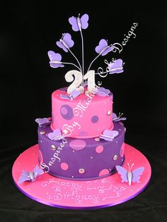 Pink and purple cake minus the butterflies! i'll take stars!