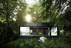 An Experimental New Hotel Includes a Steel Prefab and a Copenhagen Loft - Photo 1 of 9 - At 55 square meters, the Vipp shelter is a steel prefab whose glass doors slide open to immerse guests in nature. Architecture Design, Sustainable Architecture, Prefab Cabins, Prefab Homes, Shelter, Loft Hotel, Prefab Buildings, Urban Loft, House And Home Magazine