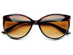 Gorgeous Womens Cat Eye Sunglasses Vintage Retro Tortoise 01731 by dc-store. $9.95. Made from High Quality Materials. 100% 400UV Protection. Retro / Vintage Style. Large round cat eye sunglasses with black color plastic frame and gray lenses.  Sunglasses dimensions:  Frame Height: 50mm Frame Width:  140mm