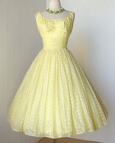 such a lovely soft yellow with white/details - 1950's lemon eyelet chiffon dress.