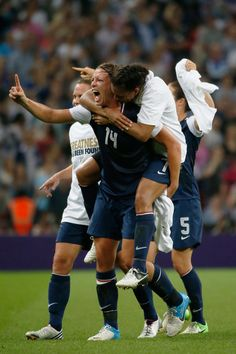 fb710c251 Shannon Boxx jumps on the back of Abby Wambach of the United States after  defeating Japan by a score of to win the Women s Football gold medal match  on Day ...