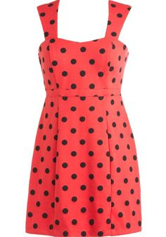 Poppy Spots Dress: Features elegant crescendo straps supporting a subtle sweetheart neckline, flattering princess seams running down the front of the dress, jubilant black polka dot print throughout, and a vibrant poppy foundation to finish.
