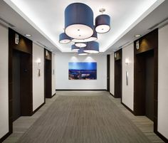 SSDG Interiors developed a new office space in Vancouver, British Columbia for global commercial real estate firm Colliers International. Commercial Real Estate, Commercial Design, Visual Merchandising, Vancouver, Columbia, Elevator Lobby, Canada, Branding, Workplace Design