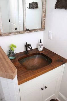 copper sink in bathroom with wood countertop Dark Wood Bathroom, Taupe Bathroom, Basement Bathroom, Bathroom Ideas, Butcher Block Countertops, Bathroom Countertops, In Law House, Types Of Countertops, Room Freshener