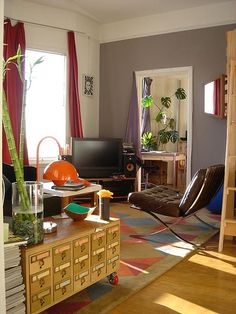 I like the non-fussy over designed feeling of this room. No gray walls, though!