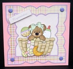 Baby girl bear in a basket card front on Craftsuprint designed by Angela Wake - made by Joyce Watson - I printed this sheet on to glossy photo paper and cut out. Attached the base image to a pink 6x6 card using DST, then added the decoupage with glue gel. Chose one of the sentiments and added with foam pads, and finished by adding lilac card candi to each corner. - Now available for download!