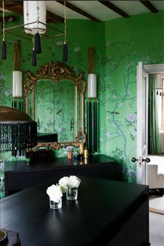 Beautiful garden escape with this bird and tree decorated wallpaper on a light green background - creating a cheerful atmospshere and really brightening up this room. Image: Livingetc