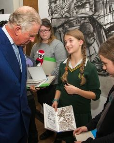 Prince Charles, Prince of Wales reacts as he is sketched by art students Josie Deighton and Claire Price during his visit to The Princ...