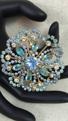 A personal favorite from my Etsy shop https://www.etsy.com/listing/269353644/vintage-multicolor-blue-rhinestone-gold
