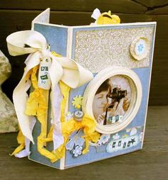 Love this--simple yet elegant.  Love the blue and yellow.   SheilaRumney.com: Mini Albums