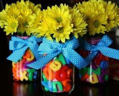 Fill jars with magnetic alphabet letters to make adorable desk vases. | 36 Clever DIY Ways To Decorate Your Classroom