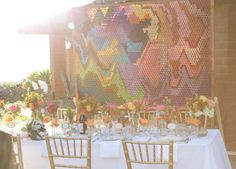 Love the DIY paper backdrop for dinner at this outdoor wedding