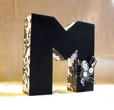 I love this simple MONOGRAM. And would you believe it is made out of a shipping box?