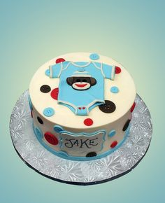 sock monkey cake i like the fondant buttons or circles and name