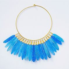 I'm so pleased with the outcome of this cerulean duck feather choker with gold and pearls. I made it for a client who wanted somethings dramatic with Grecian flair  A big thanks to those of you who have requested custom orders these past few weeks! I am currently booking new commissions for the week of June 3 onward. I will be re-launching an online shop on June 1st as well for those of you who are interested. Thanks again for your amazing feedback and support  by erinlightfeather