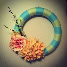 My DIY Spring wreath. Wrap your choice of color yarn around a Styrofoam craft wreath. Then glue your choice of flowers onto the wreath with a hot glue gun! Easy to make and super cute for the home!