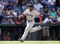 Boston Red Sox's Jackie Bradley Jr. comes around to score against the Seattle Mariners in the 10th inning of a baseball game on Thursday, July 11, 2013, in Seattle. The Red Sox won in 10 innings 8-7. (AP Photo/Elaine Thompson)