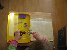 Before using this activity the child should be successful with pouring water into a single measuring spoon.  (This lesson can be found in an...