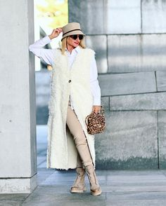 Button down shirt, skinny pants, boots, long shearling vest and hat | Photo shared by Yvonne | For more style inspiration visit 40plusstyle.com
