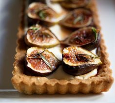 Delicious recipe for Roasted Fig Tart with Honey, Goat cheese and Mascarpone....using fresh figs, lightly roasted and caramelized in the oven.   www.feastingathome.com
