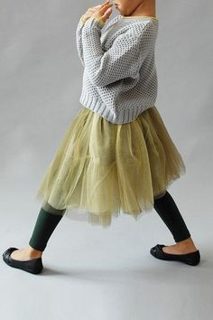 A Beautiful alternative to the Classic Pink Tutu is this Olive Bellanie  Tutu from Wunway.com.  It is truly a Tutu Skirt for Little Fashionistas-   this airy Tutu features layers of tiered ruffles and has a corsage accent  on the waist for Extra Cuteness.  I also love how it is worn with a casual  grey sweater, black leggings, and black ballet flats… Tres Chic!