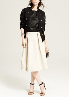 Glam rock! Love the embellished bomber jacket paired with a gorgeous midi skirt.