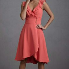 BHLDN Anthropologie Quillaree Coral Wrap Dress Perfect condition. Too small for me :( Wrap style front with 3 hidden button closure and three antique bronze exposed button closure. Hi-lo hemline. Size 2. Stock photo shows true color most accurately. By QUILAREE sold at Anthropologie. Needs a dry clean. Anthropologie Dresses