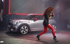 Natalie La Rose sings during as the Mini John Cooper Works concept is unveiled during media previews during the 2014 North American International Auto Show in Detroit.