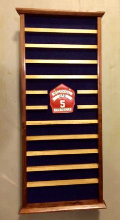 Custom solid oak and Walnut military firefighter coin holder. $250. If you are interested in a shadow box, flag case, coin rack, or anything one-off, contact Tom @ jenkswood@gmail.com or 719-359-0361 Challenge Coin Display, Challenge Coins, Shadow Box Display Case, Firefighting, Military Life, Law Enforcement, Solid Oak, Wood Working, Leo