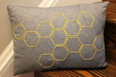 Bees! I'd make a complimentary pillow with the shape of a honeybee, if it's not too difficult.