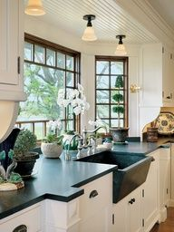 I love the deep bay window behind sink with potted flowers:)