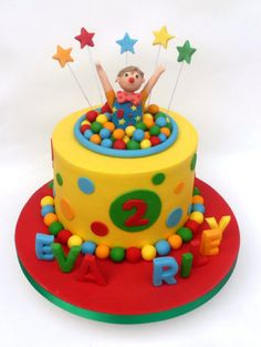 Mr Tumble joint birthday cake - stars and balls
