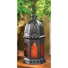 Amber Glass Moroccan Lantern🕯🏮 Create a mood of mystery and romance anywhere with this enchanting cutwork lantern. Amber glass diffuses a candle's glow to fill your surroundings with dancing light and color. Combine several for a truly magical display! Lantern Candle Holders, Candle Lanterns, Glass Candle, Candles, Lantern Lamp, Candleholders, Lantern Centerpiece Wedding, Wedding Lanterns, Wedding Centerpieces