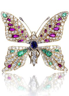 A diamond and gem-set butterfly brooch late 19th/early 20th century The head, thorax and abdomen set with an oval-cut sapphire and cushion-shaped diamonds, the eyes with cabochon rubies, the wings pavé-set with old brilliant, cushion, single and rose-cut diamonds, and vari-cut emeralds and rubies, the antennae with rose-cut diamond tips, the legs and abdomen with engraved decoration, mounted in yellow gold, diamonds approximately 4.50 carats total, French assay marks.